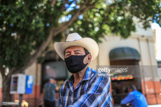 An adult man with a cowboy hat uses a mask to visit the Municipal Market as a preventive measure against the spread of COVID-19 13, 2020 in...