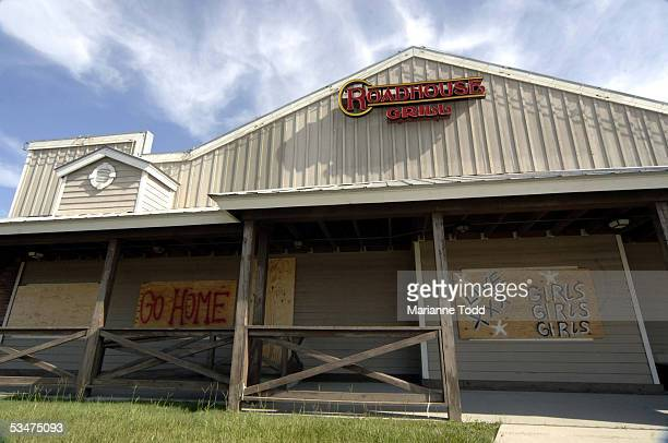 An adult nightclub is seen boarded up prior to Hurricane Katrina making landfall August 28 2005 in Biloxi Mississippi A mandatory evacuation order...