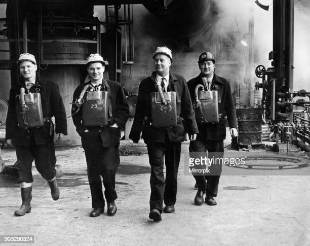 An advance guard of the army of steelworkers who returned to their jobs at Port Talbot after the strike which lasted six weeks. Men wearing gas...