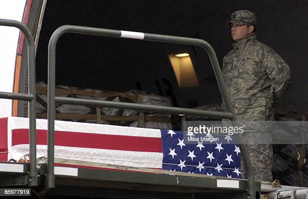 An advance team member stands with the remains of Army Specialist Michael Anaya of Crestview FL at Dover Air Force Base April 14 2009 in Dover...