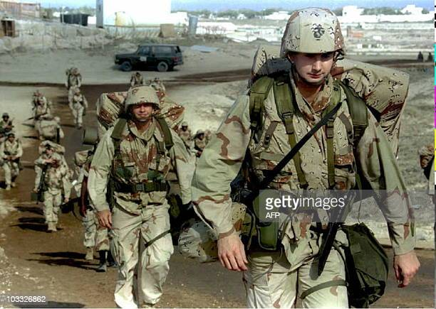 An advance team of 100 US Marines patrol the airport in Mogadishu shortly after their arrival on shore 27 February Operation United Shield which is...