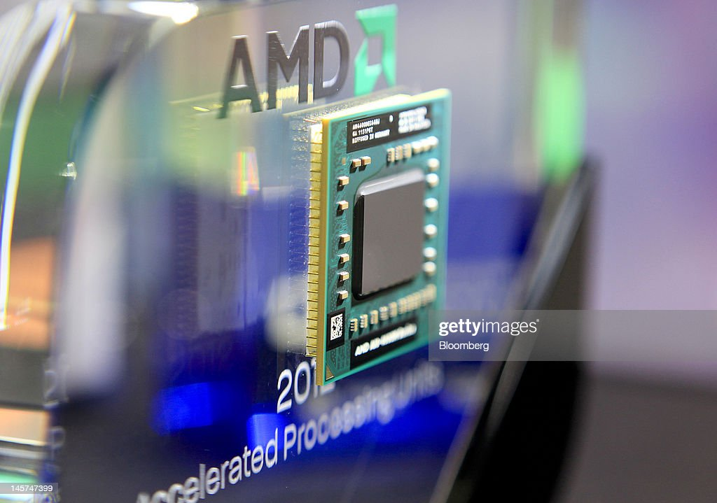 An Advanced Micro Devices Inc. AMD-A10-4600M Series APU computer chip is displayed at the AMD booth at Computex Taipei 2012 in Taipei, Taiwan, on Tuesday, June 5, 2012. Computex Taipei 2012 takes place from June 5 to June 9. Photographer: Ashley Pon/Bloomberg via Getty Images