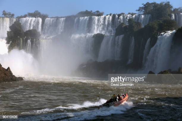 An adventure boat takes tourists for a soaking under the Iguacu Falls on the Argentinian side of the Iguazu River August 13 2009 on border between...