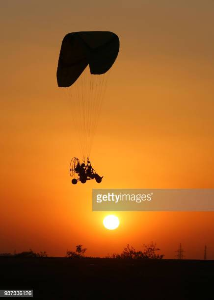 An adventure enthusiast enjoy paramotoring during Bhoj Adventure Fest at Kaliasot Ground in Bhopal on March 24 2018 Bhoj Adventure fest is a popular...