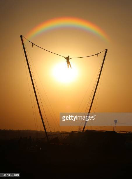 TOPSHOT An adventure enthusiast enjoy reverse bungee during Bhoj Adventure Fest at Kaliasot Ground in Bhopal on March 24 2018 Bhoj Adventure fest is...