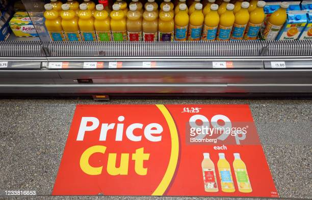 An advert for fruit juice on the floor in a Morrisons supermarket, operated by Wm Morrison Supermarkets Plc, in Saint Ives, U.K., on Monday, July 5,...