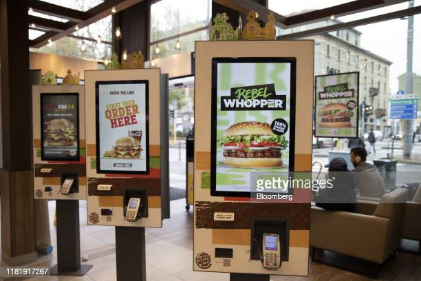 An advert for the meatfree Rebel Whopper burger is displayed on digital order kiosk at a Burger King Holdings Inc fastfood restaurant in Milan Italy...
