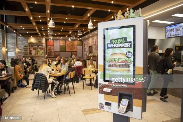 An advert for the meatfree Rebel Whopper sits on digital order console at a Burger King Holdings Inc fastfood restaurant in Milan Italy on Tuesday...