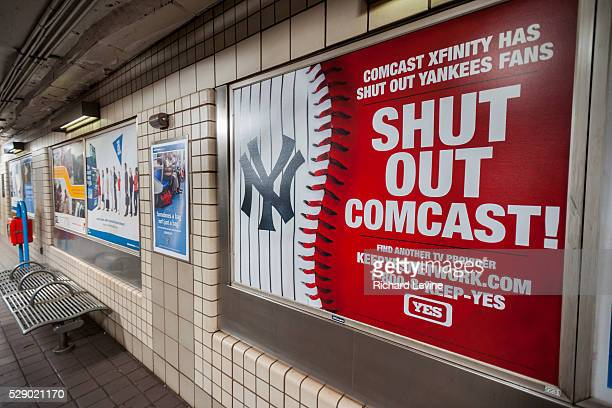 An advertisement by the YES Network in a PATH station in New York on Friday, March 11, 2016 urges viewers to dump Comcast as their cable television...