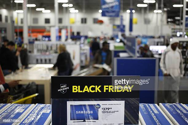 An advertisement displays product information for Samsung Electronics Co televisions at a Best Buy Co store ahead of Black Friday in Chesapeake...