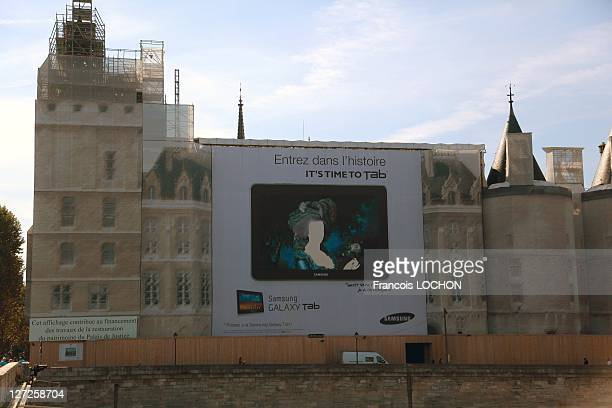 An advertisement featuring the image of MarieAntoinette adorns the wall of the Conciergerie on September 26 2011 in Paris France In 1793 Marie...