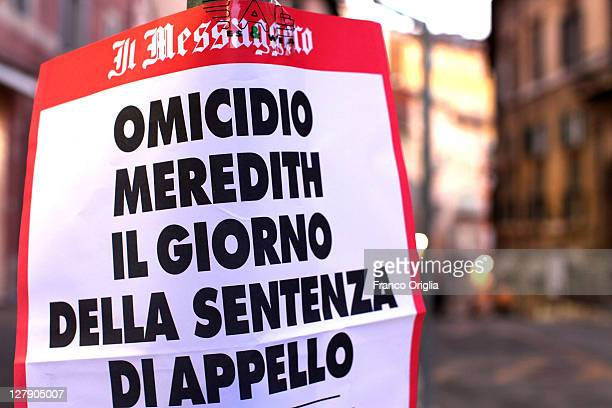 An advertisement for a newspaper announces the day of the verdict in Amanda Knox and Raffaele Sollecito's appeal of their murder convictions on...