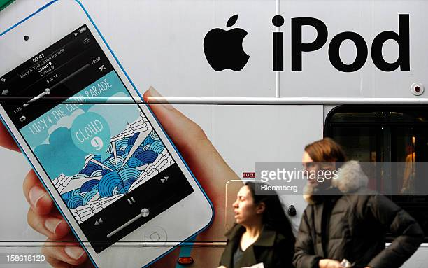 An advertisement for an Apple Inc iPod is displayed on the side of a London bus in London UK on Friday Dec 21 2012 Britain's economy expanded less...