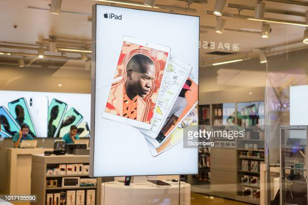 An advertisement for Apple Inc iPad tablets sit in the window of a authorised reseller in the Nisantasi district of Istanbul Turkey on Wednesday Aug...