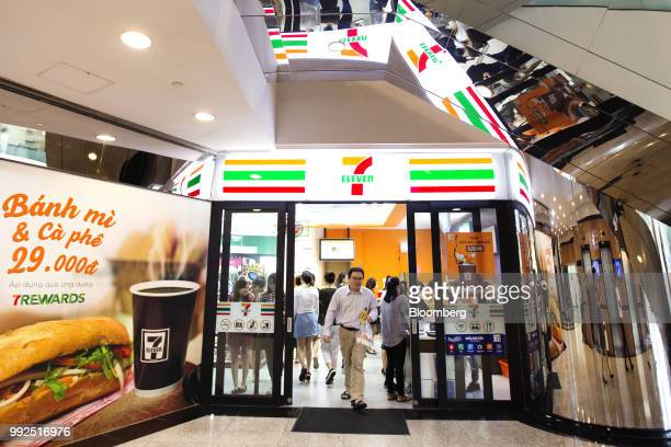An advertisement for banh Mi sandwiches is displayed as a customer exits a 7Eleven store in Ho Chi Minh City Vietnam on Wednesday June 20 2018 For...