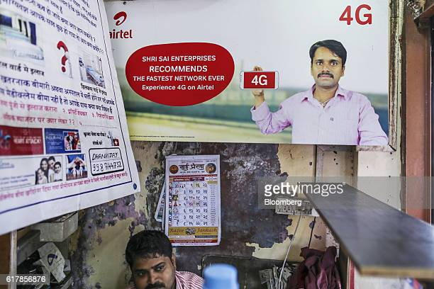 An advertisement for Bharti Airtel Ltd is displayed inside a mobile phone store in Mumbai India on Monday Oct 24 2016 Bharti Airtel is scheduled to...