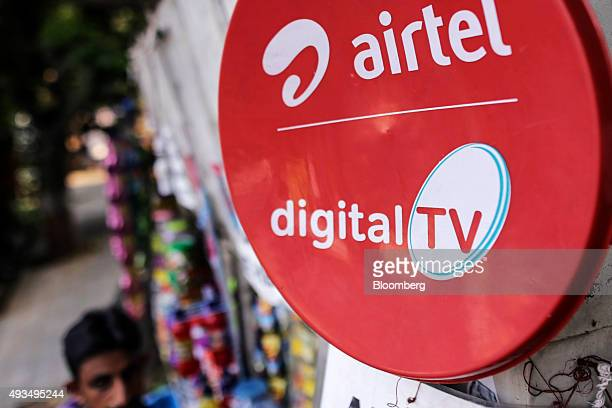 An advertisement for Bharti Airtel Ltd is displayed outside a store in Mumbai India on Monday Oct 19 2015 Bharti Indias largest wireless carrier is...