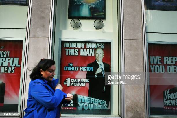 An advertisement for Bill O'Reilly's toprated Fox News show is displayed in the window of the News Corporation headquarters on April 5 2017 in New...