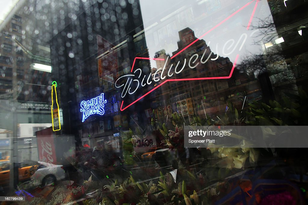 An advertisement for Budweiser beer is displayed in a deli window on February 27, 2013 in New York City. In a new class action lawsuit against Anheuser-Busch, beer enthusiasts have accused the company of watering down its Budweiser, Michelob and other beers. The suits, which were filed in Pennsylvania, California and other states, are seeking millions in damages for allegedly cheating customers out of the alcohol content stated on labels. Anheuser-Busch calls the suit groundless.