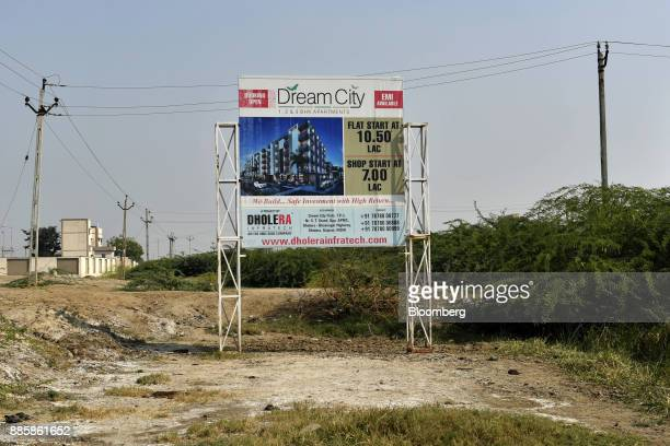 An advertisement for Dream City stands at the project site for a 920squarekilometer industrial area located on the DelhiMumbai Industrial Corridor...
