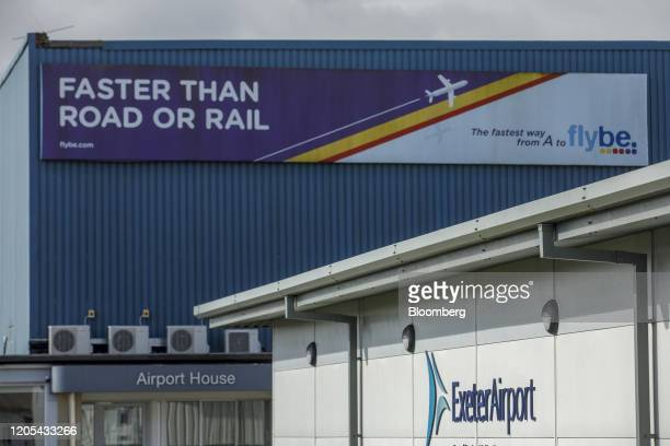 An advertisement for Flybe Group Plc sits on a building at Exeter Airport in Exeter UK on Friday March 6 2020 Flybe Britain's biggest domestic...