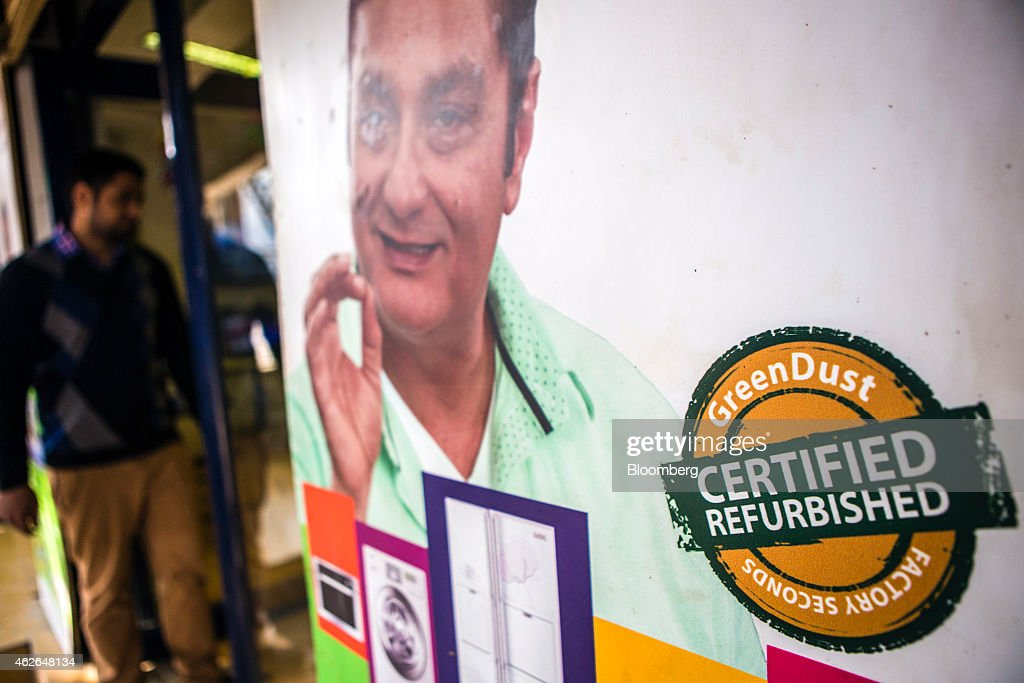 An advertisement for GreenDust, a unit of Reverse Logistics Co., is displayed outside a store in the Neb Sarai area of New Delhi, India, on Friday, Jan. 16, 2015. Reverse Logistics Co., an Indian retailer of refurbished goods, is a factory outlet store in India selling goods through its GreenDust brand franchise stores and website. Photographer: Prashanth Vishwanathan/Bloomberg via Getty Images