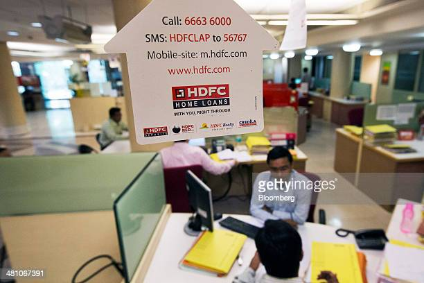 An advertisement for Housing Development Finance Corp is displayed inside the bank's branch in Mumbai India on Monday Feb 17 2014 Mistry has been...