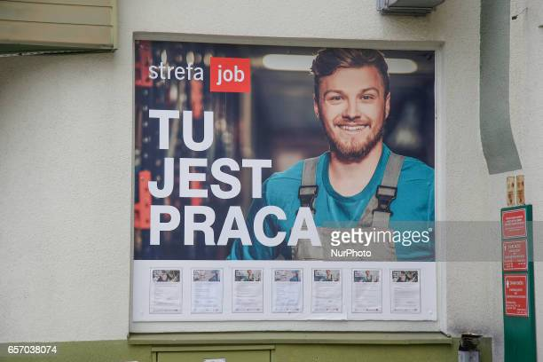 An advertisement for jobs is seen from a temp agency in Bydgozcz Poland on 23 March 2017
