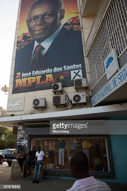 An advertisement for Jose Eduardo dos Santos Angola's president sits on a billboard in Luanda Angola on Saturday Nov 9 2013 Angola the largest crude...