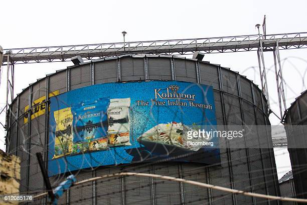 An advertisement for Kohinoor Foods Ltd products is displayed at a rice mill in Karnal Haryana India on Thursday May 19 2016 A good monsoon season...