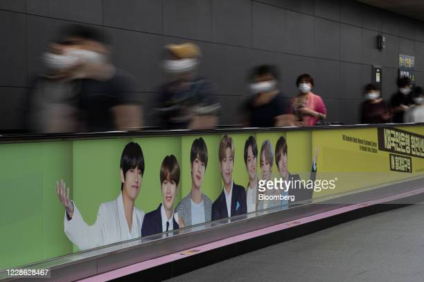 An advertisement for K-pop boy band BTS is displayed on a travelator at a subway station in Seoul, South Korea, on Friday, Sept. 18. 2020. Big Hit...