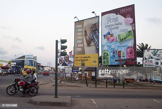An advertisement for MTN Group Ltd mobile communications and Dream Cosmetics sit on a roadside in Accra Ghana on Tuesday Sept 20 2016 Ghana's central...
