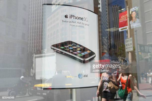 An advertisement for the Apple iPhone is displayed in the window of an AT&T Wireless store July 23, 2008 in San Francisco, California. AT&T reported...