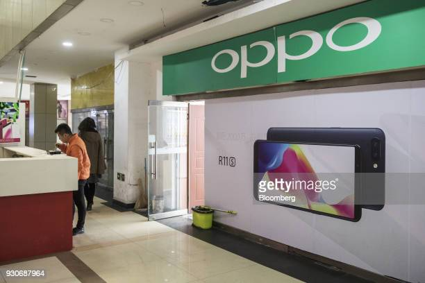 An advertisement for the Oppo R11S smartphone is displayed at a store in Beijing China on Wednesday March 7 2018 China's consumer inflation surged to...