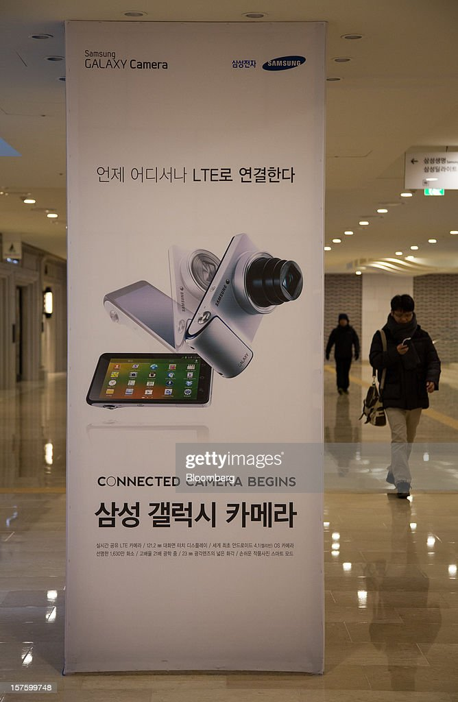 An advertisement for the Samsung Electronics Co. Galaxy camera is displayed at the company's flagship store in Seoul, South Korea, on Wednesday, Dec. 5, 2012. Samsung Electronics Co. promoted Lee Jae Yong to vice chairman, putting him a step closer to succeeding his father as leader of the world's biggest maker of televisions and mobile phones. Photographer: SeongJoon Cho/Bloomberg via Getty Images