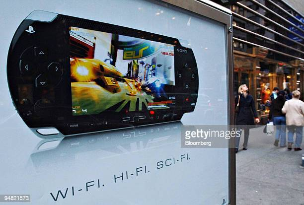 An advertisement for the Sony PlayStation Portable hangs on the back of a public phone in New York on Tuesday March 22 2005