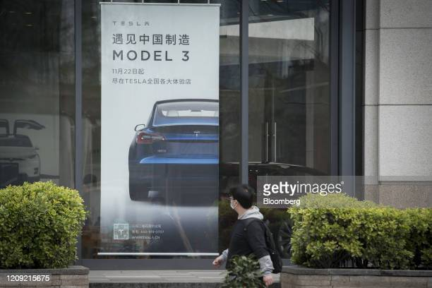 An advertisement for the Tesla Model 3 is displayed at a Tesla Inc dealership in Shanghai China on Monday April 6 2020 China the biggest market...