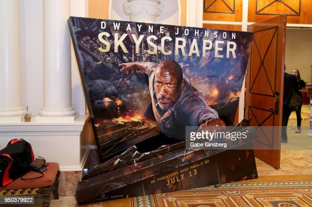 An advertisement for the upcoming Skyscraper movie is displayed at Caesars Palace during CinemaCon the official convention of the National...