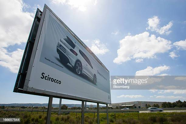 An advertisement for the VW Scirocco automobile stands outside the Volkswagen Autoeuropa factory operated by Volkswagen AG near the A1 highway in...
