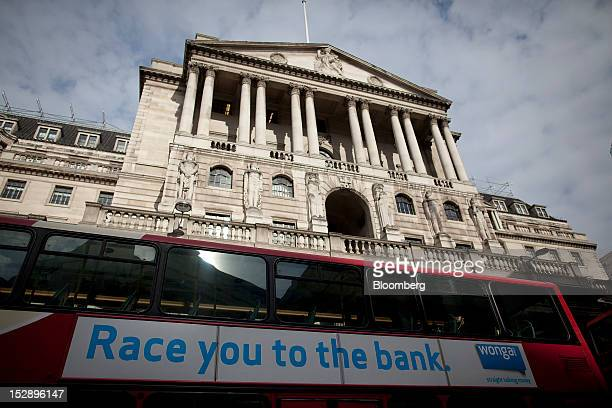 An advertisement for Wongacom Ltd which reads ''race you to the bank'' is seen on the side of a London bus as it passes the Bank of England in London...
