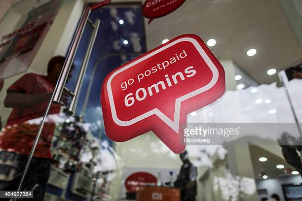 An advertisement is displayed on the door of a Bharti Airtel Ltd store in Mumbai India on Saturday Feb 28 2015 The government auction of telecom...