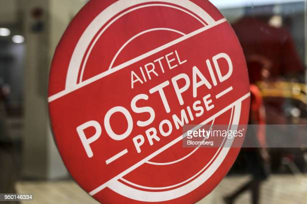 An advertisement is displayed on the door of a Bharti Airtel Ltd store in Mumbai India on Saturday April 21 2018 Bharti Airtel are scheduled to...