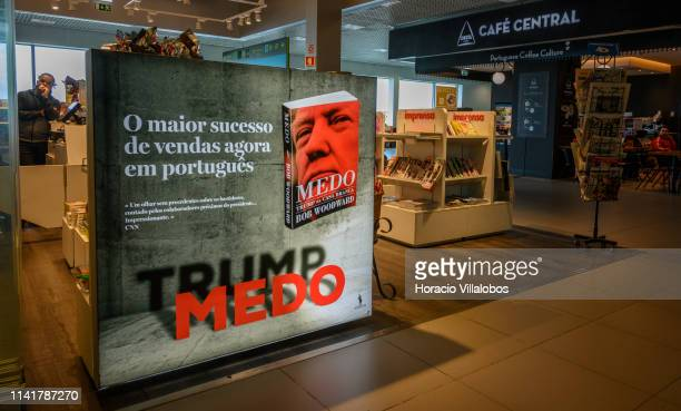 An advertisement of the Portuguese edition of Bob Woodward's book about the Trump White House Fear is on display at passengers' lounge of Humberto...