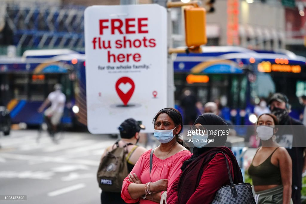 An advertisement offering free flu shots is seen during the... : News Photo