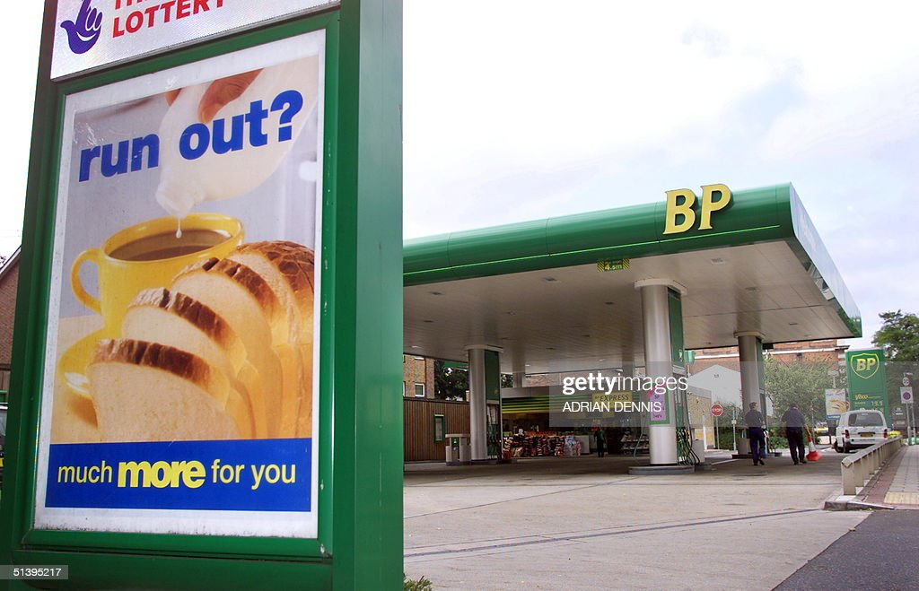 An advertisement outside a B.P petrol station in W : News Photo