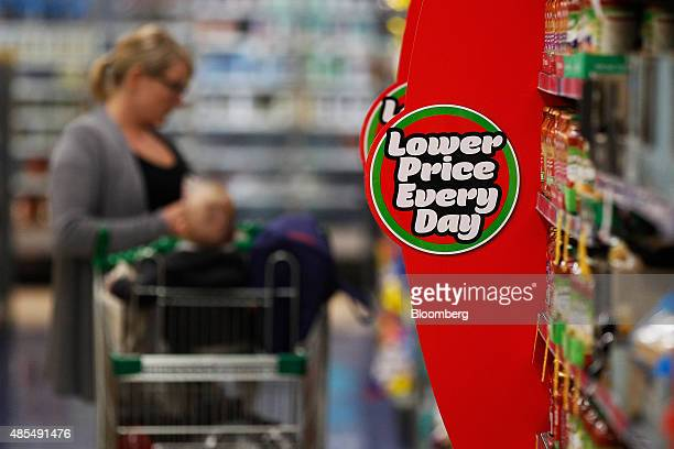 An advertisement reading 'Lower Price Every Day' is displayed at a Woolworths Ltd supermarket in Sydney Australia on Thursday Aug 27 2015 Woolworths...