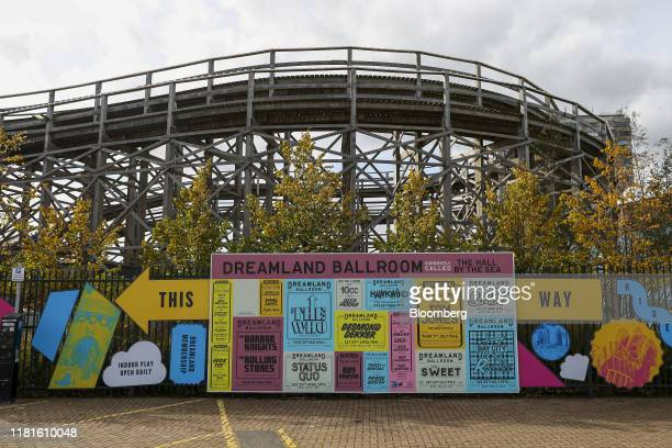 An advertisement sits near the entrance of Dreamland resort in Margate UK on Thursday Oct 10 2019 Nick Niell the man behindArrowgrass Capital...