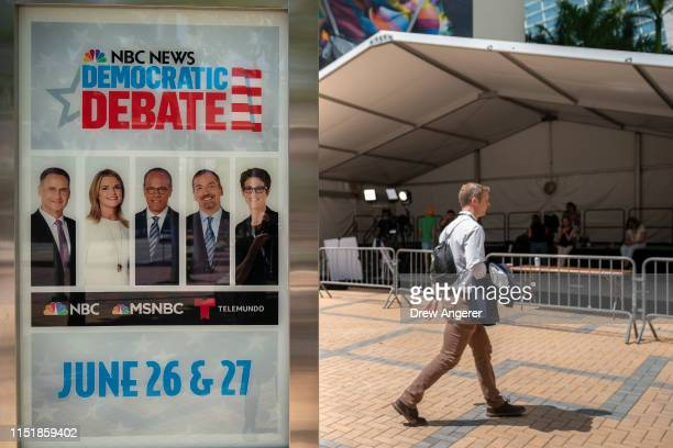 An advertisement touts the first Democratic presidential primary debates for the 2020 elections outside the Adrienne Arsht Center for the Performing...