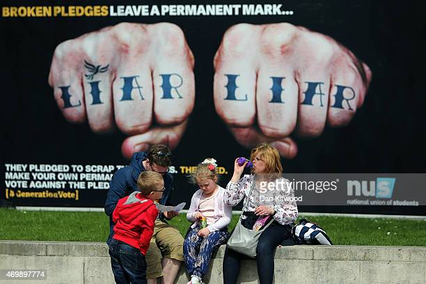 An advertisement van with the words 'Liar Liar' emblazoned on the side drives around Parliament Square on April 16 2015 in London England The vans...