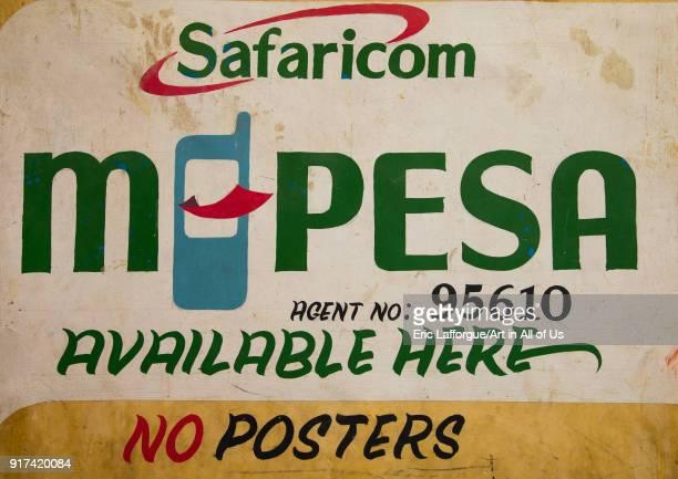 An advertising bilboard for safaricom telecom company mobile payment called mpesa Lamu County Lamu Town Kenya on December 20 2017 in Lamu Town Kenya